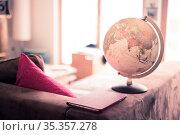 Planning the next journey: Globe in the living room, nobody. Стоковое фото, фотограф Zoonar.com/Patrick Daxenbichler / easy Fotostock / Фотобанк Лори