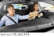 car driving school instructor teaching woman. Стоковое фото, фотограф Syda Productions / Фотобанк Лори