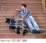 Disabled man on wheelchair having trouble with stairs. Стоковое фото, фотограф Elnur / Фотобанк Лори