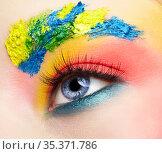 Close-up macro shot of teenager girl eye with unusual art make-up. Стоковое фото, фотограф Serg Zastavkin / Фотобанк Лори