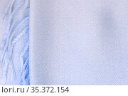 Background textile with a texture of a knitted scarf with a fringe, blue fabric with a color gradient in pastel shades, clothing and accessories. Стоковое фото, фотограф Светлана Евграфова / Фотобанк Лори