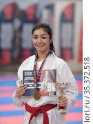 Девушка победитель соревнований фестиваля единоборств. Редакционное фото, фотограф Дмитрий Неумоин / Фотобанк Лори