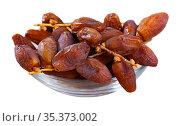 Sweet dried dates in plate. Стоковое фото, фотограф Яков Филимонов / Фотобанк Лори