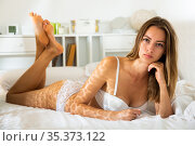 Woman posing in underwear in bed. Стоковое фото, фотограф Яков Филимонов / Фотобанк Лори