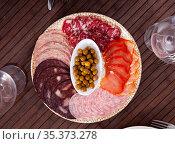 Slices of Spanish dry-cured gammon, variety of sausages. Стоковое фото, фотограф Яков Филимонов / Фотобанк Лори