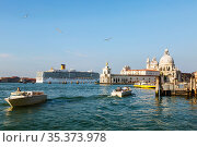 View of the Grand Canal, the Cathedral of Santa Maria della Salute and the cruise ship in the Venetian Lagoon sailing to the port. Venice, Italy (2017 год). Редакционное фото, фотограф Наталья Волкова / Фотобанк Лори