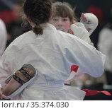 Соревнования по карате среди девочек, фокус на спине. Редакционное фото, фотограф Дмитрий Неумоин / Фотобанк Лори