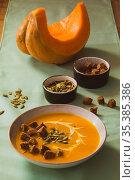 White ceramic bowl of pumpkin cream soup, served with homemade croutons... Стоковое фото, фотограф Zoonar.com/OKSANA SHUFRYCH / easy Fotostock / Фотобанк Лори
