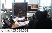 Navigation control room in the airport - a man working with a monitor with fly paths placed on the map. Стоковое видео, видеограф Константин Шишкин / Фотобанк Лори