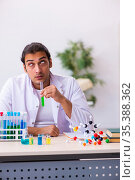 Young male chemist working in the lab. Стоковое фото, фотограф Elnur / Фотобанк Лори