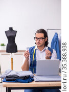 Young male tailor working at workshop. Стоковое фото, фотограф Elnur / Фотобанк Лори