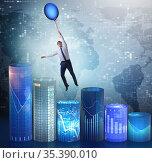 Businessman flying on hot balloon over graph. Стоковое фото, фотограф Elnur / Фотобанк Лори