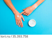 Woman applying white cream on skin of her hand with index finger.... Стоковое фото, фотограф Zoonar.com/Jakub Mrocek / easy Fotostock / Фотобанк Лори