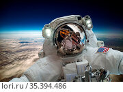 Astronaut in outer space against the backdrop of the planet earth... Стоковое фото, фотограф Zoonar.com/Andrey Armyagov / easy Fotostock / Фотобанк Лори