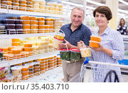 Mature couple husband and wife choose sauerkraut cabbage and pickles in supermarket. Стоковое фото, фотограф Татьяна Яцевич / Фотобанк Лори