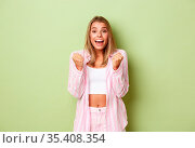Image of beautiful hopeful woman winning something and saying yes... Стоковое фото, фотограф Zoonar.com/Seva Levitsky / easy Fotostock / Фотобанк Лори