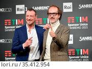 Sanremo Festival host and artistic director, Amadeus, and Stefano... Редакционное фото, фотограф Maria Laura Antonelli / AGF/Maria Laura Antonelli / age Fotostock / Фотобанк Лори