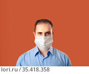 Protection against contagious disease, coronavirus, covid-19. Man wearing hygienic mask to prevent infection, airborne respiratory illness such as flu, 2019-nCoV. indoor isolated on white background. Стоковое фото, фотограф Александр Сергеевич / Фотобанк Лори