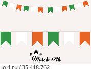 March 17th text with irish flag bunting on white background. Стоковое фото, агентство Wavebreak Media / Фотобанк Лори