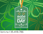 Sale st patrick's day text on green tag over green patterned background. Стоковое фото, агентство Wavebreak Media / Фотобанк Лори