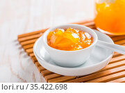 Lemon curd or fruit jelly in small bowl and glass jar for breakfast... Стоковое фото, фотограф Zoonar.com/Ingrid Balabanova / easy Fotostock / Фотобанк Лори