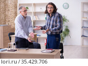 Two employees in bankruptcy concept. Стоковое фото, фотограф Elnur / Фотобанк Лори