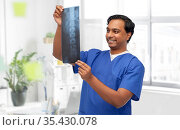 happy indian doctor or male nurse with x-ray. Стоковое фото, фотограф Syda Productions / Фотобанк Лори