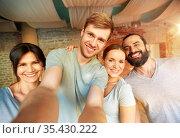 happy friends at yoga studio or gym taking selfie. Стоковое фото, фотограф Syda Productions / Фотобанк Лори