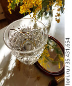 Натюрморт с букетом мимозы и бокалом вина. Стоковое фото, фотограф Марина Володько / Фотобанк Лори