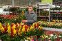 Man choosing potted flowers in garden store. Стоковое фото, фотограф Яков Филимонов / Фотобанк Лори