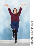 Caucasian stylish pregnant businesswoman posing with hands up. Стоковое фото, фотограф Кекяляйнен Андрей / Фотобанк Лори