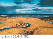 Europe. Aerial View Of Dry Grass And Partly Frozen Curved River Landscape... Стоковое фото, фотограф Ryhor Bruyeu / easy Fotostock / Фотобанк Лори