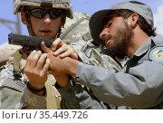 AFGHANISTAN Sar Hawza-- 30 Aug 2006 -- US Army Specialist Patrick... Редакционное фото, фотограф Jonathan William Mitchell / age Fotostock / Фотобанк Лори