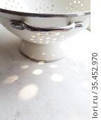 White, iron colander on gray background. Стоковое фото, фотограф Марина Володько / Фотобанк Лори