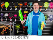 male holding new rocket and balls for padel. Стоковое фото, фотограф Яков Филимонов / Фотобанк Лори