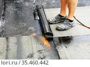 Professional flat roof waterproofing with bitumen welded sheeting. Стоковое фото, фотограф Udo Herrmann / easy Fotostock / Фотобанк Лори