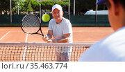 mature sportsman playing at tennis court. Стоковое фото, фотограф Татьяна Яцевич / Фотобанк Лори