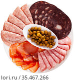 Antipasto platter with various meat and olives. Стоковое фото, фотограф Яков Филимонов / Фотобанк Лори