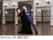 Man and woman amateur dancers laugh during classical dance with each other. Стоковое фото, фотограф Евгений Харитонов / Фотобанк Лори
