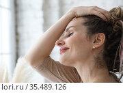 Portrait of a smiling woman in good mood indoors. Стоковое фото, фотограф Алексей Кузнецов / Фотобанк Лори