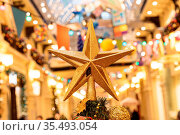 Christmas background with decorative star, fir branches and pine cones... Стоковое фото, фотограф Zoonar.com/Ruslan Gilmanshin / easy Fotostock / Фотобанк Лори