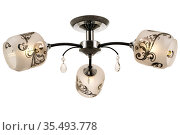 Black three-lamp ceiling lamp with chrome base and matt cylindrical shades with floral ornaments. Isolated on white background. Стоковое фото, фотограф Вадим Орлов / Фотобанк Лори