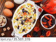 Pumpkin casserole with dried fruits. Стоковое фото, фотограф Надежда Мишкова / Фотобанк Лори