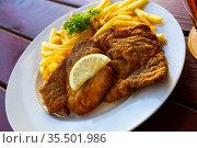 Breaded pork schnitzel with fried potatoes. Стоковое фото, фотограф Яков Филимонов / Фотобанк Лори