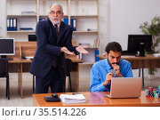 Two male employees in gambling concept. Стоковое фото, фотограф Elnur / Фотобанк Лори