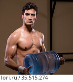 Muscular ripped man with big water bottle. Стоковое фото, фотограф Elnur / Фотобанк Лори
