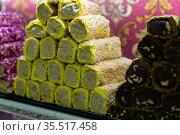 Turkish delight with multi-colored sprinkles, almonds and coconut. Стоковое фото, фотограф Яков Филимонов / Фотобанк Лори