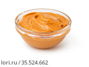 Glass bowl of peanut butter isolated on white background. Стоковое фото, фотограф Zoonar.com/Serghei Platonov / easy Fotostock / Фотобанк Лори