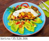 Stuffed tasty eggplant baked with vegetables and cheese. Стоковое фото, фотограф Яков Филимонов / Фотобанк Лори