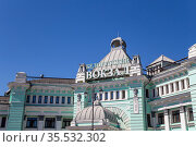 Belorussky railway station (written in Russian)-- is one of the nine main railway stations in Moscow, Russia. It was opened in 1870 and rebuilt in its current form in 1907-1912 (2015 год). Редакционное фото, фотограф Владимир Журавлев / Фотобанк Лори